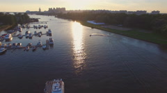 Aerial view of marina full yachts and boats at sunset Stock Footage