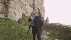 4K Female rock climber hiking to location to begin a climb Stock Footage
