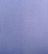 Macro shot of a blue net like textile with backlight - stock photo