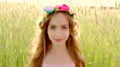 Close up of young girl wearing flower wreath in sunset Stock Footage