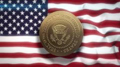 USA Presidential Seal spinning in front of stars and stripes - stock footage