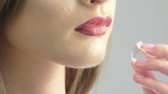 Close up of claret woman's lips with ice cube in profile. Slow motion Stock Footage