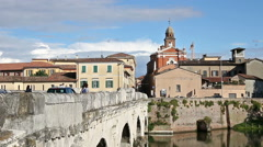 Tiberius bridge and old buildings Rimini Stock Footage