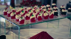 Candy bar. Table with sweet  candies. Wedding cake - stock footage