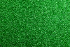 Artificial turf. Studio shot. Green background. Copy space Stock Photos