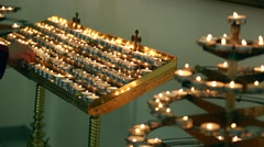 Candles in a church - stock footage
