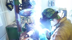 Man with welding helmet welding machine steel Stock Footage