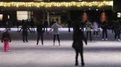 People skating on the ice rink toronto during Christmas epoch Stock Footage