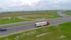 Cars on a road. Aerial View of Driving trucks, cars on a freeway - stock footage