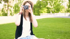 Close-up shot of a woman with retro camera film making photos Stock Footage