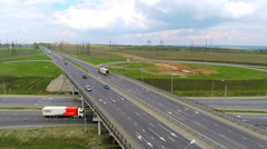 Aerial view of a truck and other traffic driving along a country road Stock Footage
