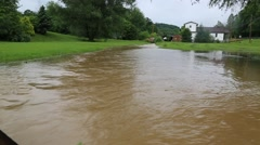 River flooding lawn in front of farm house in West Virginia after storms (HD) Stock Footage