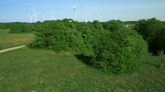 Aerial Shot of Wind Energy Power Plant with Clusters of Wind Turbines - stock footage