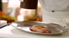 Pepper dispenser over raw meat. - stock footage