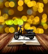 Motorcycle on open book, Travel with motobike story concept - stock photo