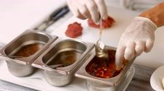 Hands with meat and spoon. Stock Footage