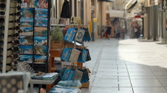 Shopping street in the Greece. Defocuse tourists with different activities. Stock Footage