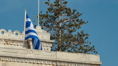 Greek flag on the blue sky background. Stock Footage