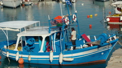 Small fishing ship is moored in the Heraklion harbor, Crete island, Greece. Stock Footage