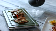 Meat on dark green tray. Stock Footage