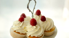Finished cupcakes with white cream and raspberries Stock Footage