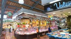 Mercat de la Llibertat people shopping buying food like a local Stock Footage