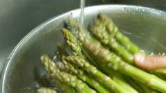 Male hands wash asparagus. Stock Footage
