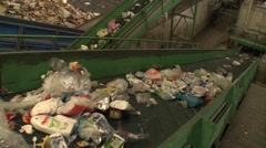 trash to recycle in a conveyor belt in recycling center - stock footage