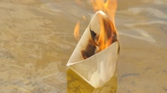 Paper Ship in Flame on the Watery Surface Dreams Did Not Come True Lost Hope Stock Footage