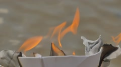 Paper Ship is Burning on Watery Surface Flame Dreams Did Not Come True Lost Stock Footage