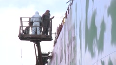 Workers washing ship in dry dock Stock Footage