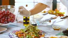 Spoon pours sauce onto salad. Stock Footage