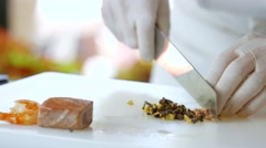 Hands with knife cut anchovies. - stock footage