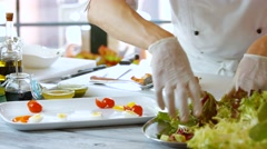 Hands put salad on plate. Stock Footage