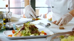 Hands put meat on salad. Stock Footage
