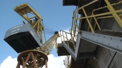 Worker climbing dry dock iron staircase with crane in background Stock Footage