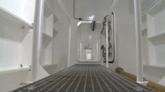 Worker going through ship corridor passageway Stock Footage