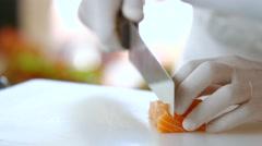 Kitchen knife cuts raw fish. - stock footage