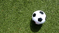 Footballer with orange shoes leading the ball, top view - stock footage