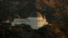 Aerial view of Observatory at Griffith Park Los Angeles at sunrise Stock Footage