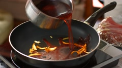 Red liquid pours on pan. - stock footage