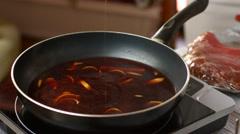 Spoon mixes liquid on pan. Stock Footage
