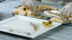 Spatula putting fish onto plate. Stock Footage