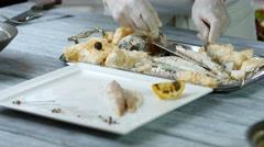Spatula puts piece of fish. Stock Footage