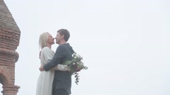 Couple kissing on the roof Stock Footage
