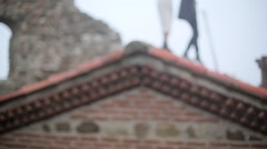 Couple walking on the roof of old building - stock footage