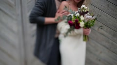 Couple hugging on the background of wooden door Stock Footage