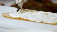 Spatula putting cream on shortcake. Stock Footage