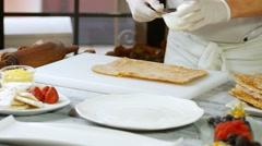 Spatula puts cream on shortcake. Stock Footage