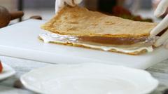 Hands put shortcake on cream. Stock Footage
